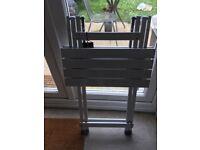 Foldable metal table