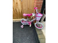 Childrens Pink and White Bike with basket.