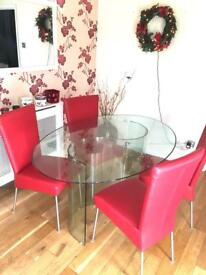 Dining table and four red leather chairs