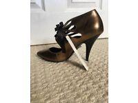 Brand new, never worn high heel shoe, size 4