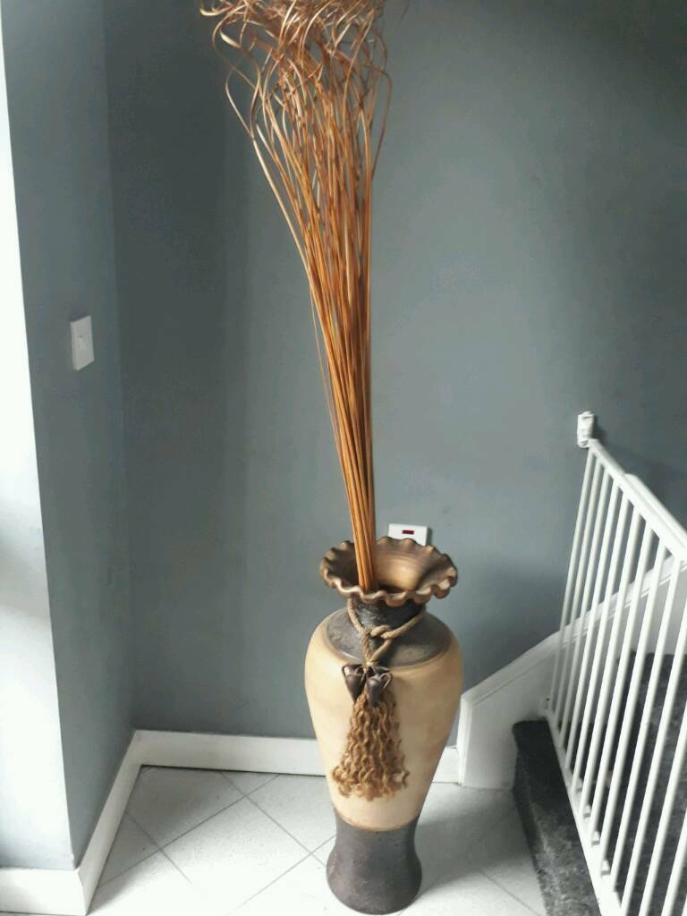 Large floor vase and three table vases with fowers