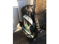 Brand new still in box 5 pockets all zipped external putter bay rain hood and bag also waterproof
