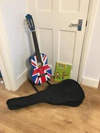 Half size guitar with case, stand and beginners book