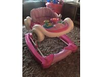 Pink/white motorcar 2 in 1 babywalker. Excellent condition.