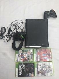 Xbox 360 with games,headset and 2 controllers.