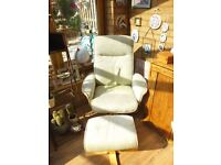 Green reclining swivel chair with separate foot rest
