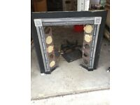 Metal fire place surround and tiles