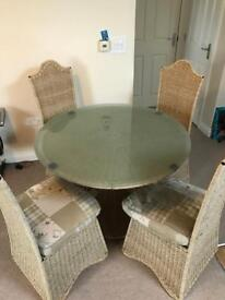 Iron and wicker table with glass top and 4 chairs