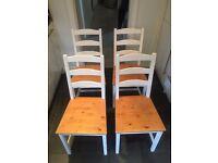 4 white wooden ikea kitchen chairs