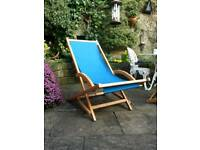 Wooden rocking deckchair with blue cover