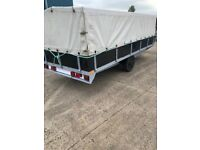 large covered trailer 16 feet by 6 with drop side and rear