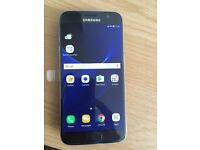 Samsung Galaxy S7 SM-G930F 32GB Black Simfree Factory Unlocked Used + Wireless Charger And Cases