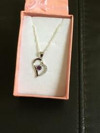 Ladies pendant and chain with a purple stone marked 925 new