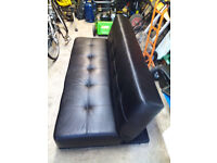 Black Leatherette Bed Setee in good condition, rarely used.