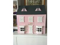 Wooden doll house with plastic stable and 2 horses