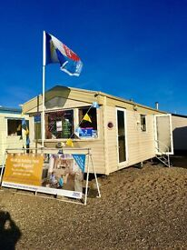 STATIC CARAVAN FOR SALE WITH SEA VIEW PITCH. SITED ON NORFOLK COAST. NEAR GREAT YARMOUTH. NR BROADS