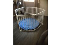 Lindam baby playpen with a playmat.