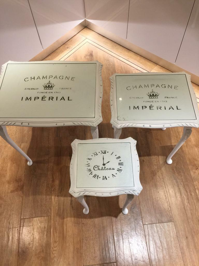 Shabby chic painted tablesin Bromsgrove, WorcestershireGumtree - Shabby chic Painted nest of tables Chalk painted Etched to age Stencilled under glass tops
