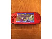 Red psp slim console 32gb 14,000 games