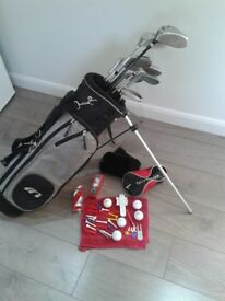 NICE SET OF JUNIOR GOLF CLUBS + GOLF BAG WITH STAND AND HOOD + GOLF BALLS + LOADS OF EXTRAS FREE