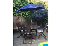 Garden table and chairs - including cushions and umbrella