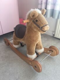 Mamas and papas ride on rocking horse
