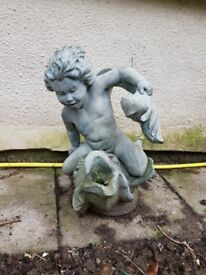 Fish and boy water feature.