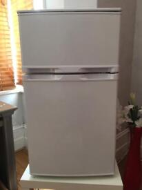 Argos under counter compact Fridge/Freezer less than 2 months old. Cost £129.99 new. Bargain!