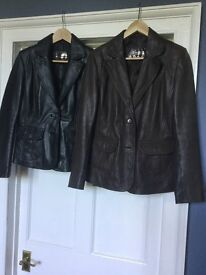 One brown and one black leather jacket