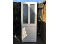 Half glazed four panel internal wood door