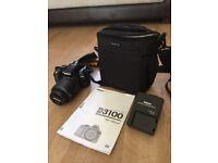 Nikon D3100 digital camera and bag.
