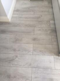 White grey large laminate flooring with brand new underlay