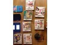 Nintendo ds lite complete with games charger and cases
