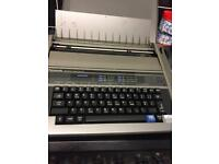 Desk top computer and electronic typewriter