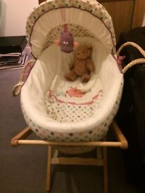 Moses basket, stand, brand new mattress and two used sheets.