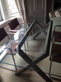 Glass dining table and four Matteo Grassi classic ding chairs, £200