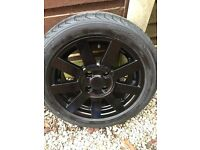 4 x 15inch alloy wheels refurbished in black. Part worn tyres just fitted. Fit Ford Fiesta, ka mk1