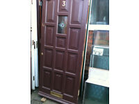 Exterior hardwood door with small glass panel