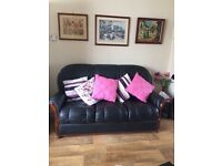 Real leather black 3 peice suite. 3 and 1 and 1. Sofa and two chairs