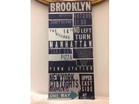 Vintage style metal wall hanging new york