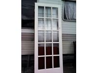 Two glass panel doors30 x77 1\2 inch