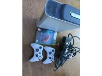 X Box 360 console and 2 controllers