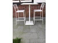 White metal table and 2 chairs