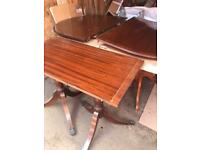 Dark wood extending twin pedestal dining table