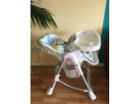 High chair for feeding baby in good condition, white and grey.