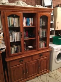 Handmade kitchen dresser with glass fronted cabinet.