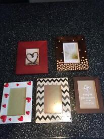 Various ornaments + flowers and tall Vase + picture frames