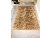 Large gold shaggy rug. 170 x 110. Immaculate condition.