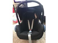 Maxi cosi car seat and 2 apdapters.
