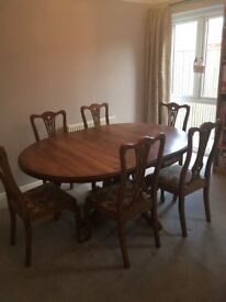 Table & 6 chairs. Extends from circular Pine table to oval. All excellent condition.